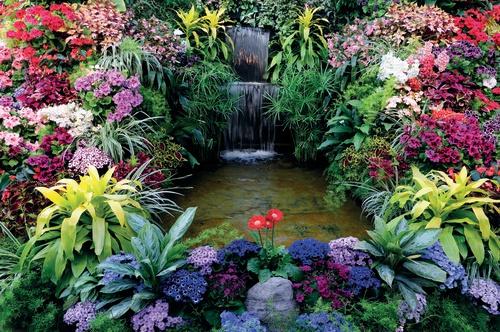 tuindoek kleurige waterval met veel bloemen