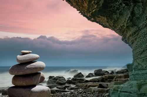 Boedha poster met stenen opgestapeld