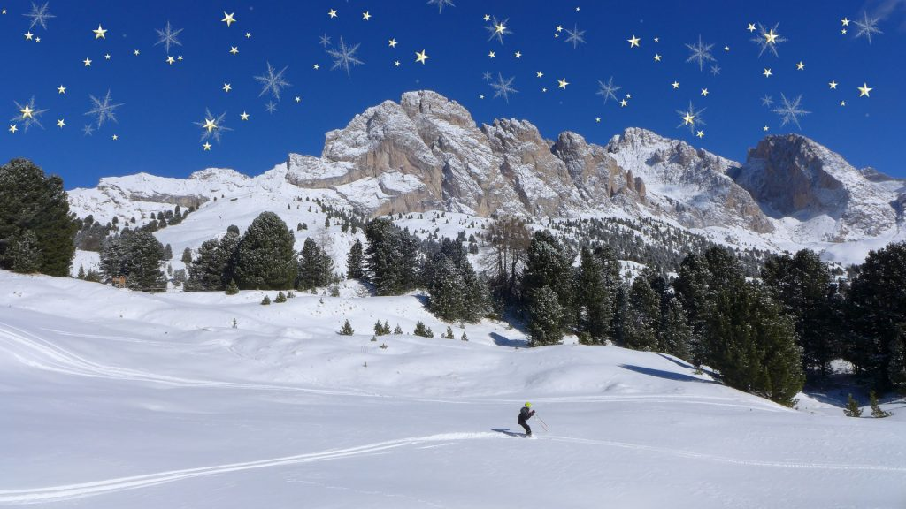 kerstdorp achtergrond skiër in winters landschap met sterrenhemel