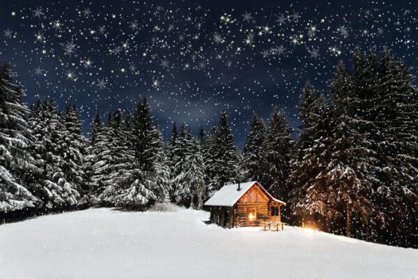 kerstdorp achtergrond Winterlandschap met sterrenhemel en dwarrelende sneeuwvlokken
